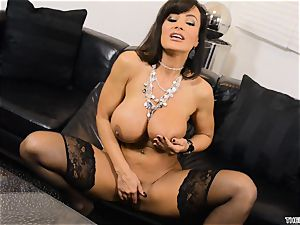 Lisa Ann thrusts her dildo deep in her raw cunny