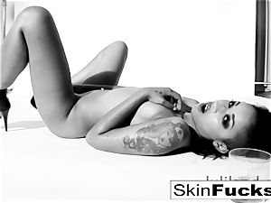 skin Diamond playing with her moist labia