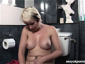 brit blonde cougar Tracey Venus showers and strokes
