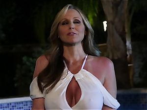 Julia Ann deep-throats a group of rods in a pool
