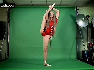 red clad Gymnast Doing spreads
