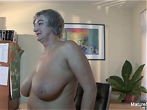 Mature plumper takes a explosion on her ample innate globes